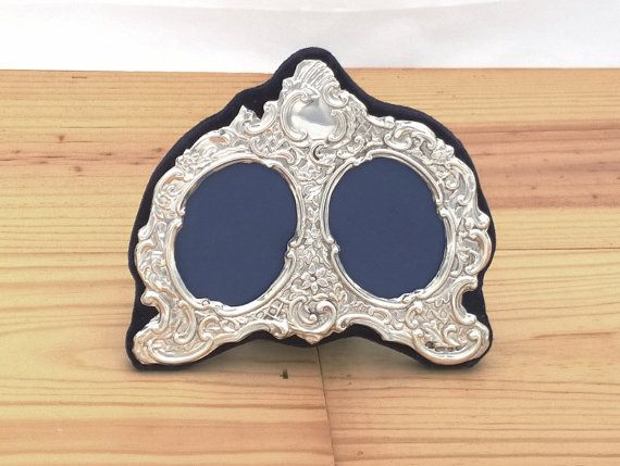 New and handmade Victorian style 999 Britannia silver double photo picture frame. Hallmarked Birmingham 2015, takes two small photos.
