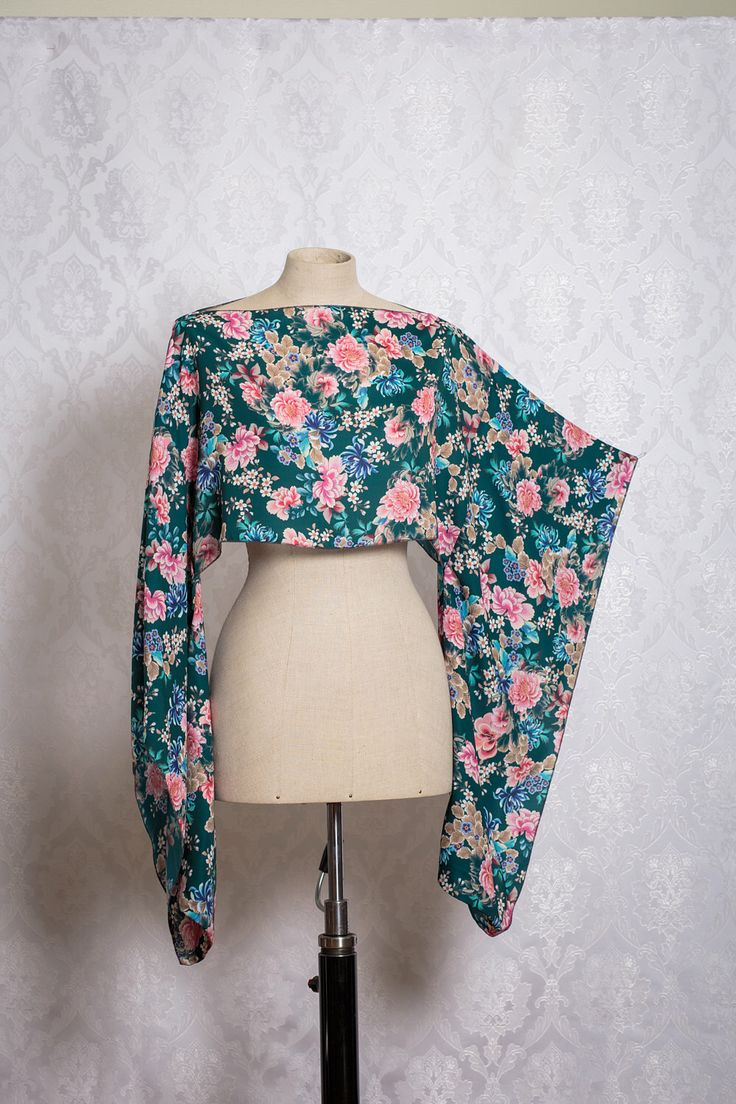 A personal favourite from my Etsy shop https://www.etsy.com/listing/523850177/green-floral-satin-kimono-sleeve-top