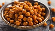 """Roasted Chickpeas """"Not only are chickpeas a nutrient-dense food, providing protein, dietary fiber, folate, iron, and phosphorus, but roasting them with a mix of exotic spices turns them into a kind of savory candy,"""" says Eve Fox, food and health blogger. Rinse a can of garbanzo beans (to eliminate some of the sodium), toss in oil, and bake at 350 degrees for about 40 minutes. Then toss with no-salt seasonings of your choice. Try curry powder, paprika, cumin, or chili powder for a spicy kick."""
