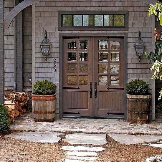 Iron strap hinges and tall escutcheons backing the doorknobs on a set of double doors imparts an old-fashioned, barn-like look to this front stoop: http://www.bhg.com/home-improvement/door/exterior/farmhouse-front-door/?socsrc=bhgpin043014hardcorehardware&page=5