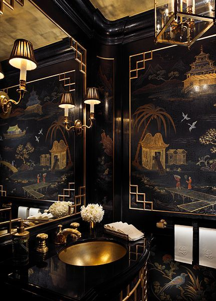 It looks like I imagine a bathroom would look on the Orient Express! Black and gold chinoiserie powder room