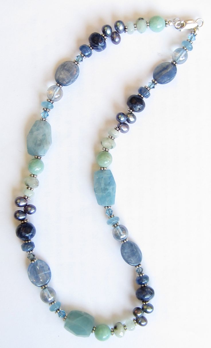 Mix of kyanite, aquamarine, lapis, amazonite, freshwater pearls, & glass from Blue Door Beads