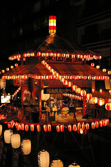 Summer festival . The lanterns are rocking by the drum.