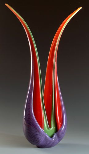 Purple, orange red, and green glass vase or sculpture.  Ed Branson, glass art