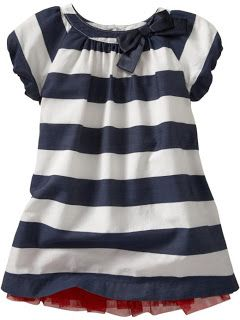 Simple Little Girl Dress Tutorial (I prefer the navy blue stripes fabric to the brown/orange circles fabric that she uses in the tutorial.)