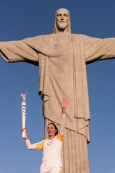 #RIO2016 Brazilian former volleyball player Isabel holds the olympic flame at Christ The Redeemder Momument on August 5 2016 in Rio de Janeiro Brazil