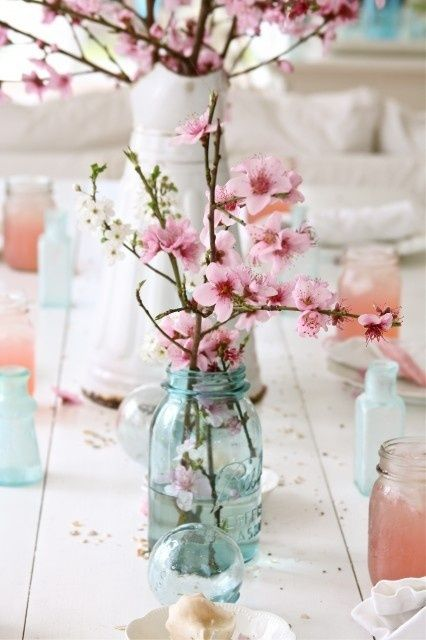 pink and light blue cherry blossom white wooden table and flowers decoration and design