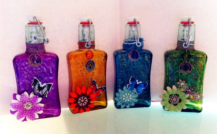 I made these using glass bottles and alcohol ink i gave for Alcohol bottles made into glasses