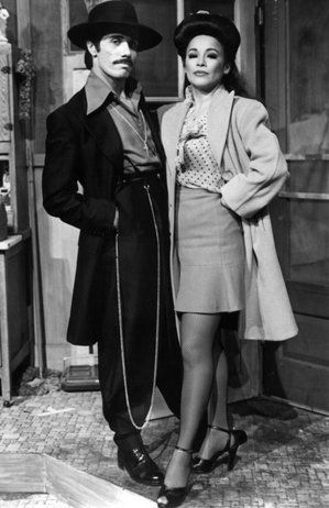 Zoot Suit:  the suits. Others say they were first worn by an African-American bus driver. Eventually the suits became more widely accepted for jitterbugging and african-american musicians. This lead many ethnicities to adopt the style in the 40s. The jacket was long with wide shoulders and long, wide lapels. The trousers were markedly pegged.