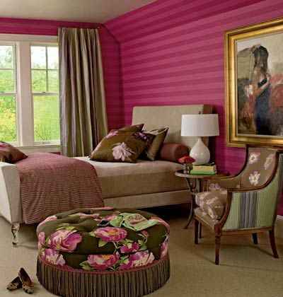 "raspberry-striped wallpaper adds a touch of Hollywood glamour. Run on the horizontal (a technique called ""railroading""), it looks modern but is cozy."