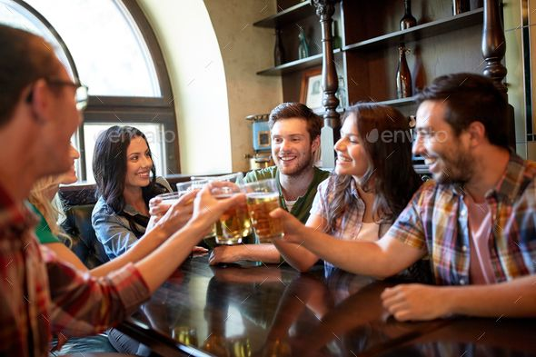 Happy friends drinking beer at bar or pub | Drinking beer, Happy ...