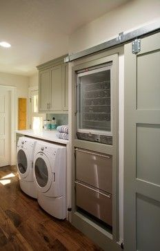 Laundry and freezer space in butler's kitchen.