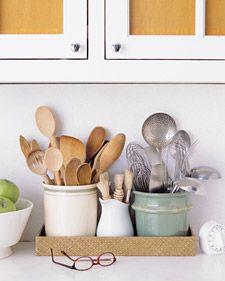 Love the organised jars of utensils on the counter, looks like a used loving kitchen rather than everything shoved in draws