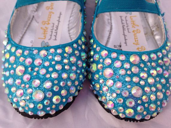 "Girls Snowflake Sparkle Party Shoes Blue by LittleBuzzyBee on Etsy.   My Frozen mad daughter loves these shoes. Glitter blue background and silver crystals adorning the shoes. A wonderful way to finish off that costume that they love to wear while singing ""let it go."" #frozen #sparkle #sparkleshoes #letitgo"