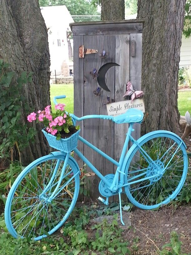 Did my own from a pinterest idea...paint the entire bike...tie wrapped a basket on the front and choose your flowers.