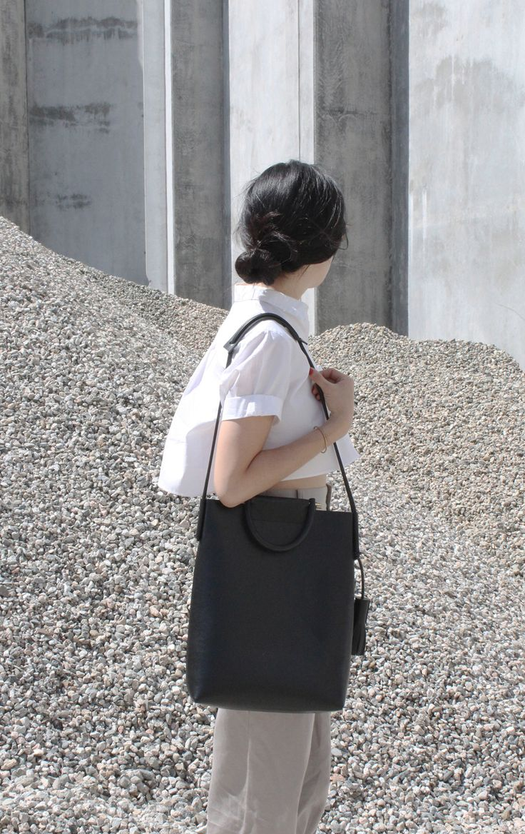 Business a modern briefcase bag 35 × 28 × 8.5 cm $690.00   Black Italian vegtan leather, Solid rubber handles, Brass hardware, Leather tassels
