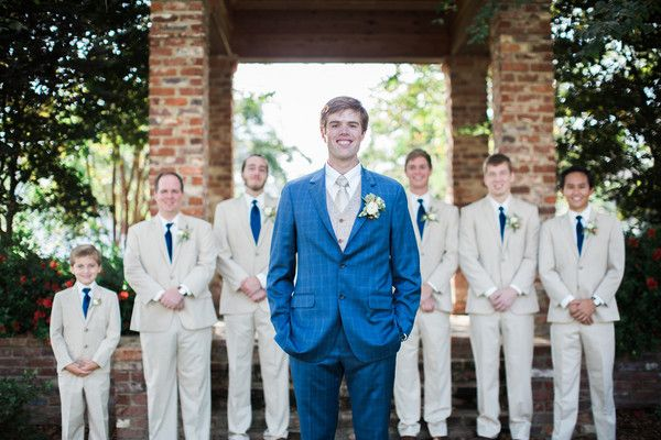 Unique groom and groomsmen outfit idea - groom in bright blue checked suit, groomsmen in khaki suits with blue ties {Taylor Square Photography Co.}