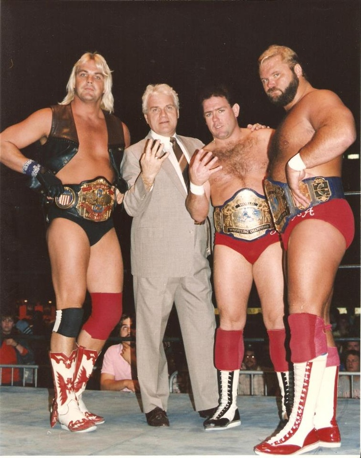 J.J. Dillon with the NWA U.S. Champion Barry Windham and NWA Tag Team Champions Tully Blanchard and Arn Anderson