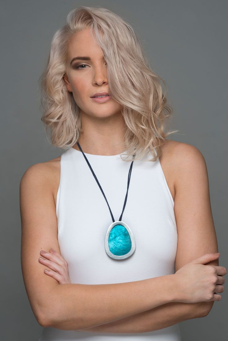 Obelia necklace - Blue. Dramatic, and eye catching our Obelia necklace is simply stunning - perfect for any special occasion. It comes in two colours Ash and Blue, and looks amazing worn with neutral block colours. A large egg shaped metal and resin pendant drop elegantly from an adjustable cord. Teamed with our Riverstone earrings and rings, it is the perfect accessory for making a statement.