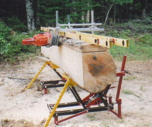 Chainsaw mill. I shall make one of these! Just what Blake needs to clear our downed trees and make wood furniture and accents.