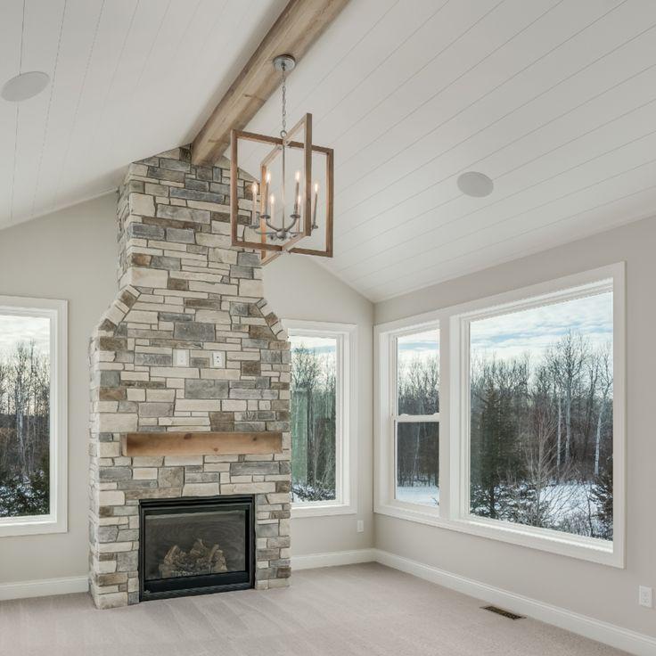 Hanson builders hearth room sunroom stone to ceiling