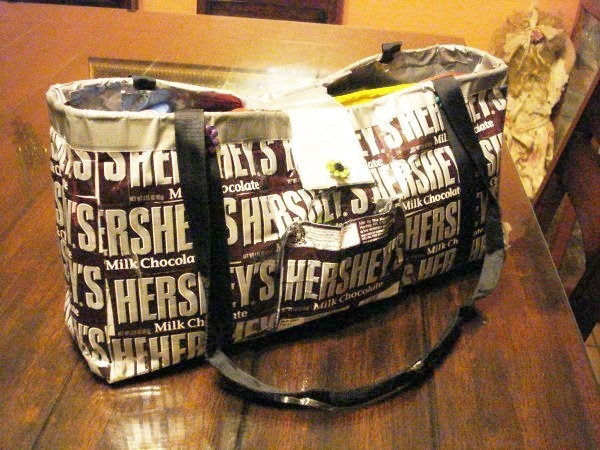 To make this purse, I used Hershey bar wrappers and duct tape. I did use some dectorative paper inside to make the pockets a little showy. It was fun and all the kids ask me where I got it and it is very durable.