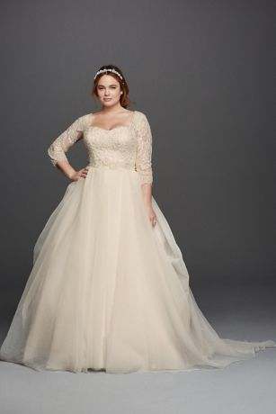 Made for the modern princess, this classic organza ball gown was designed with demure three-quarter lace sleeves and a flattering sweetheart neckline. The draping of the tulle skirt adds the perfect touch of drama.   Oleg Cassini, exclusively