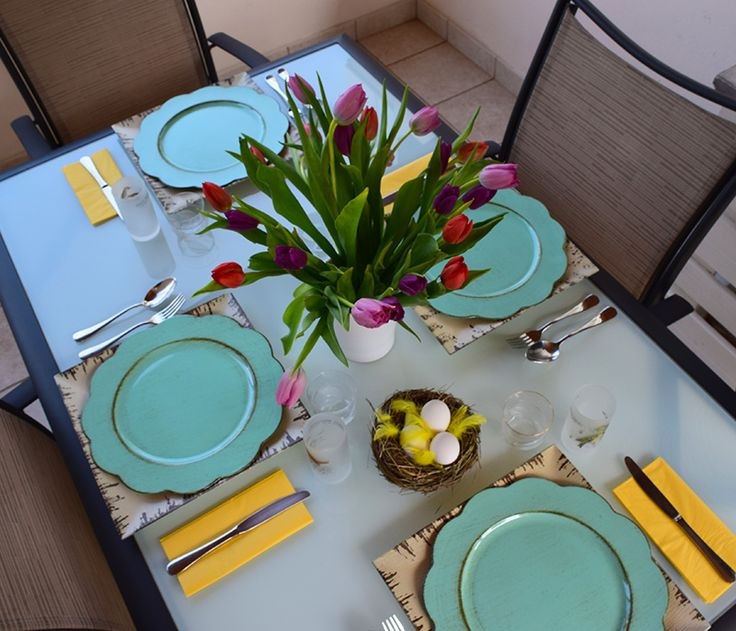 A colourful outdoor Easter table setting.