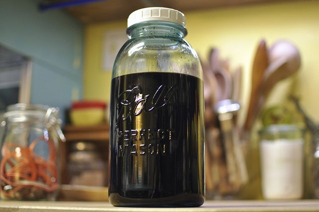 Coffee liqueur.  Substituting bourbon for vodka is quite nice!