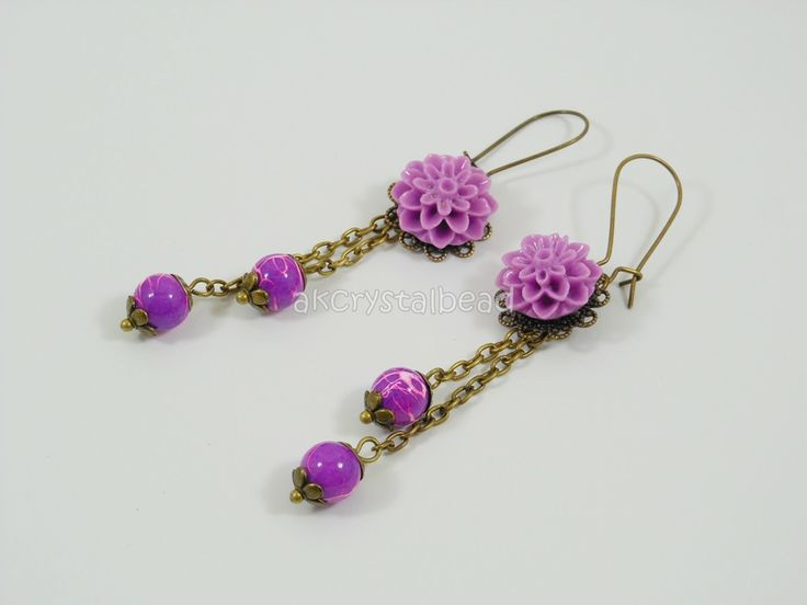 Purple violet flower cabochon and purple violet glass bead earrings. PRP0032