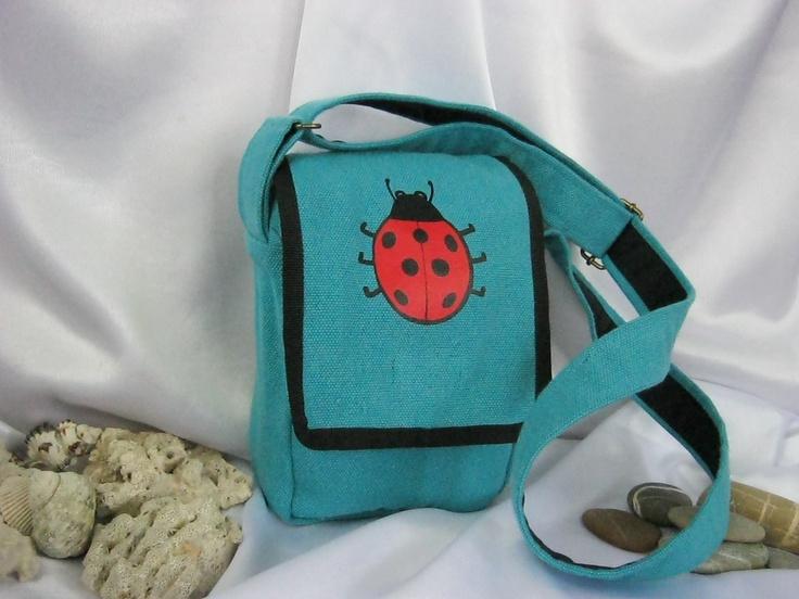 turquoise canvas bag with ladybug
