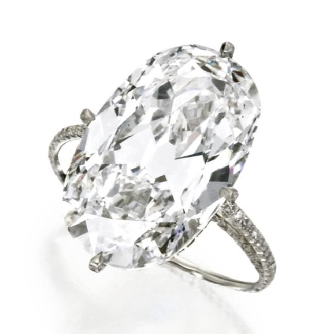 Diamond 'string' ring, JAR, Paris. Photo Sotheby's. The oval diamond weighing 16.04 carats, set within a diamond 'string' platinum mounting.