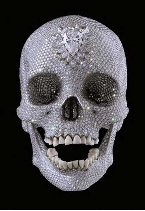 """For the Love of God"" by Damien Hirst -A ""Memento Mori"" created from a platinum cast of an 18th Century human skull encrusted with 8,601 diamonds. The pear shaped diamond at the forehead is known as the ""Skull Star Diamond"""