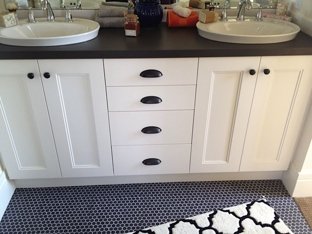 Black hex tile with white grout white cabinet with bronze cup pulls and knobs black laminate