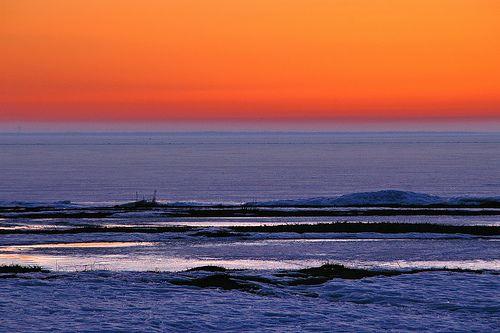 Oulu, Finland - Sunset at Frozen Baltic See (Nallikari Beach)