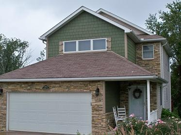 Dark Green Shingle Siding With Brown Roof Combination