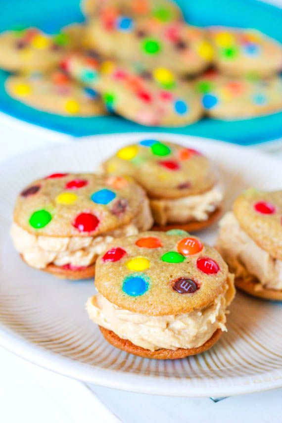 mini rainbow M cookies with peanut butter buttercreamDesserts, Peanut Butter Buttercream, Food, Decor Cookies, Ice Cream, Minis, Peanut Butter Cookies, M M Cookies, Cookies Sandwiches