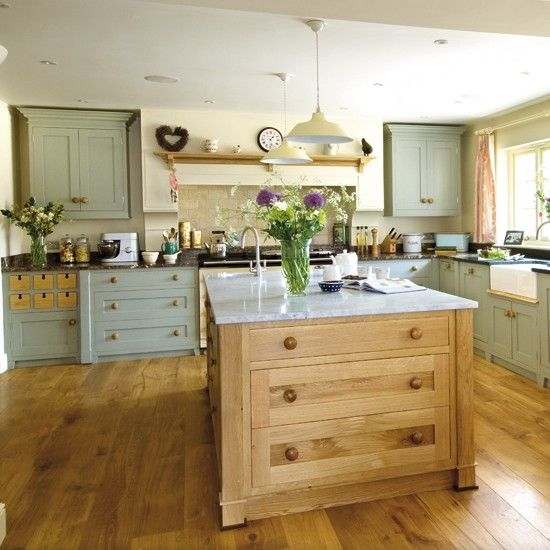This pretty country kitchen combines both painted and wood units to add a depth and sense of interest to the space