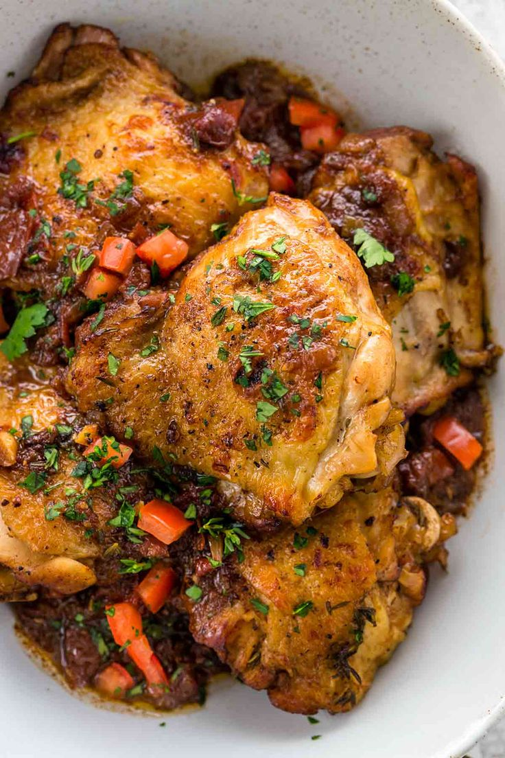 Instant Pot balsamic chicken the whole family will love. This recipe yields tender pieces of meat with crispy skin. A balsamic vinegar and tomato reduction is drizzled on top for a savory sweet sauce. #instantpot #balsamicchicken