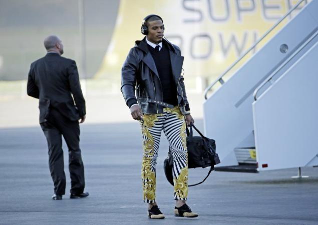 Quarterback Cam Newton walks on the wild side in his Versace pants.