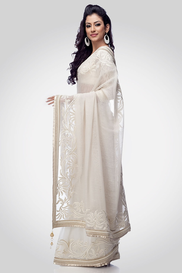 A beautiful white saree enhanced with a decorative blouse adorned with purity. This saree is a pure essence of elegance.