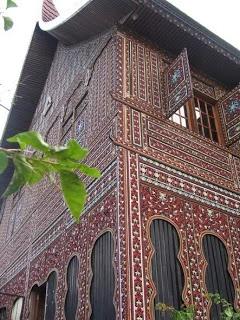Sumatra. Intricate carvings on a traditional Minangkabau house. #sumatra