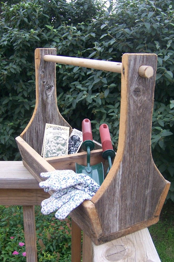 Handmade vintage barn wood garden tool tote box useful to help support yourself as you get up off the ground back onto your feet.