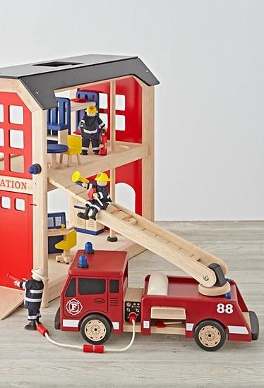 Your kids can go on tons of imaginary rescue adventures with the help of our wooden toy fire truck. It includes an extendable ladder, fire hose and side panel for extra storage.