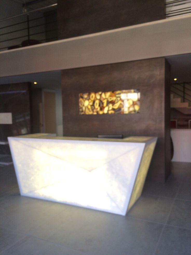 AFRIGRAN fabricated this translucent stone reception counter
