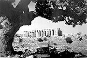 Κοντά στην Ανδρίτσαινα (14 χιλ), σε υψόμετρο 1.100 περίπου μέτρων, σε μια ποιητική  τοποθεσία  που λεγόταν Βάσσαι, βρίσκεται ο περίφημος  ναός του Επικούρειου Απόλλωνα της Φιγαλίας, που για αυτόν ο Κλεμανσώ είπε πως δεν έχει κανείς το δικαίωμα να φύγει από τον κόσμο προτού τον ιδεί. Ο ναός εκτίσθη  επάνω σε παλαιότερο ιερό του Βασσίτα Απόλλωνος από τους Φιγαλείτες  για να ευχαριστήσουν το θεό που τους ήρθε επίκουρος (βοηθός).