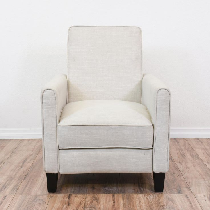 This contemporary recliner is upholstered in a durable soft light gray linen fabric. This armchair is in great condition with a tall slanted back, lift up reclining footrest and black tapered legs. Simple and modern chair with clean lines! #contemporary #chairs #recliner #sandiegovintage #vintagefurniture