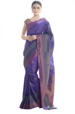 Self and Zari Woven Banarasi Saree-Be the elegant fashion diva in this exquisite blue tussar Banarasi saree. The saree features beautiful floral motifs woven body with Zari woven border and palla.This exquisite saree is beautifully textured, look classy and divine wearing this one of a kind piece.