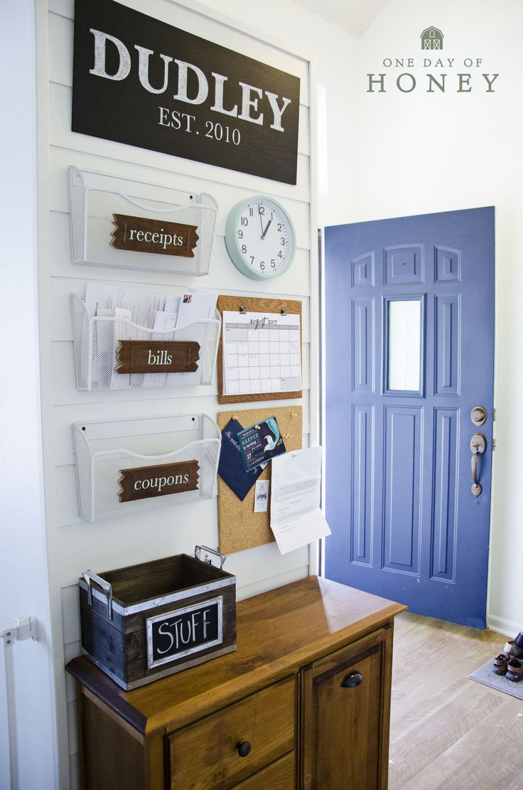 Family command centre ideas. Organise the paperwork in one location. Love the blue door and the shiplap wall. Calendar, receipts, bills, coupons.