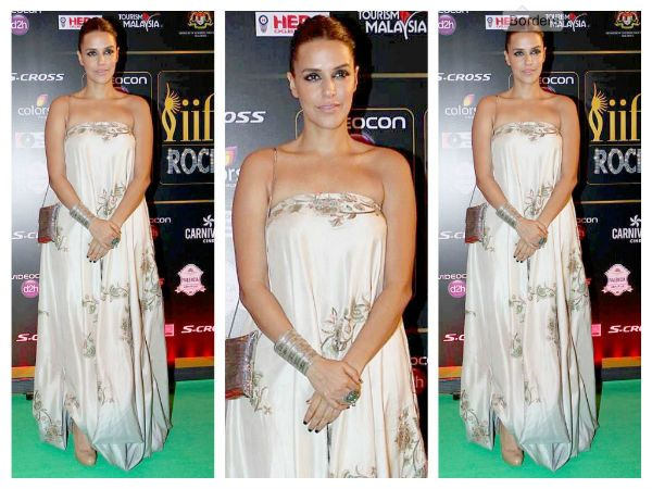 Wearing an Anamika Khanna dress with both jewelry and evening bag from Amrapali, Neha looked stunning in white at the IIFA Rocks 2015 green carpet.